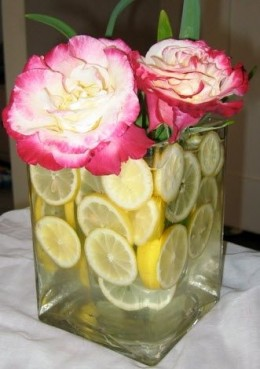 Pink peony centerpiece with lemons from do-it-yourself-weddings.com
