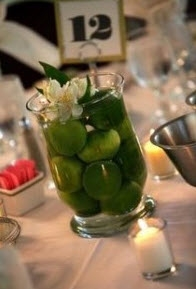 Lime Centerpiece with a single flower from budgetdreamweddings.com