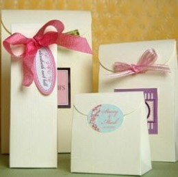 Ivory linen favor bags with ribbon, hangtags and/or labels from Beau Coup