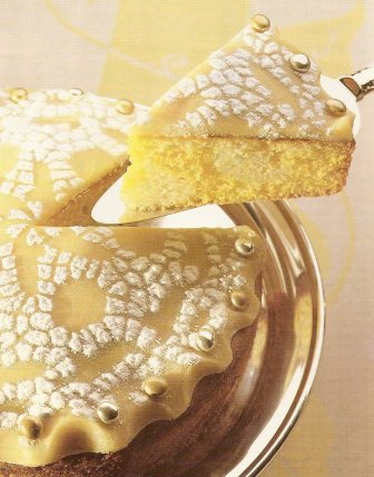 As the first slice is lifted from this almond cake, streaks of gold and silver appear. For a stronger effect, add a little yellow food coloring to the gold mixture.