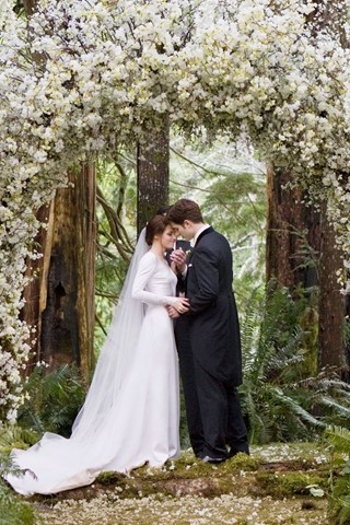 Edward and Bella married under an arch of wisteria and freesia.