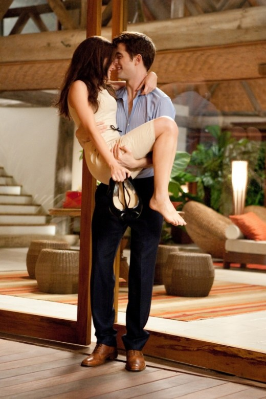 Edward carries Bella across the threshold of their honeymoon home. How much more romantic can you get!