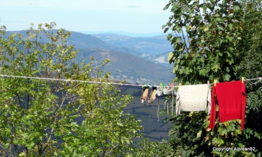 Pilgrims drying their clothes in O'Cebreiro, Galicia. A clothesline with a view, if there ever was one!