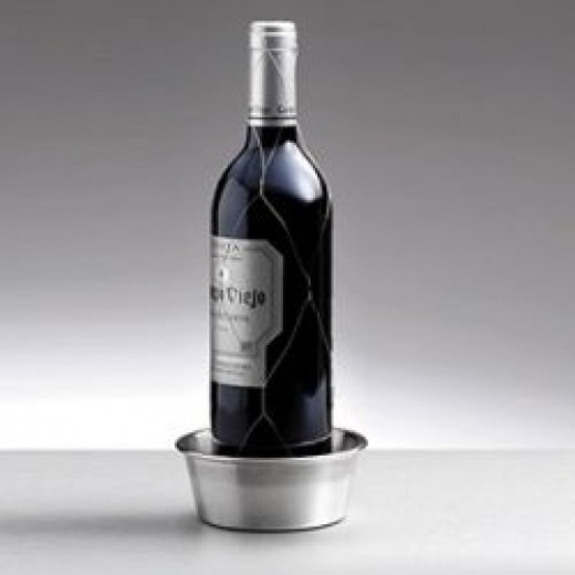 Brushed and polished steel wine bottle coaster