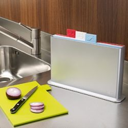 Colour coded chopping boards for vegetables, fish, raw meat and cooked food
