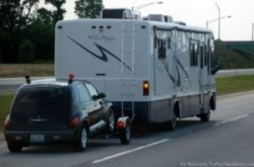 Car Behind Rv On A Tow Dolly