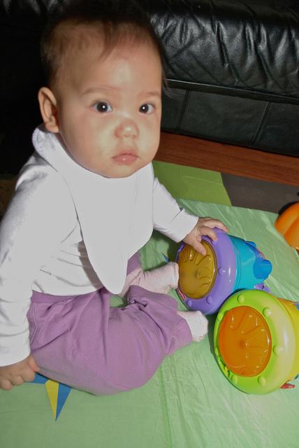Baby playing the Bongos