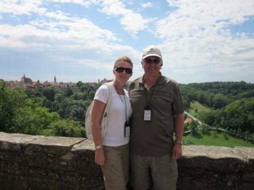 Standing near the castle garden.