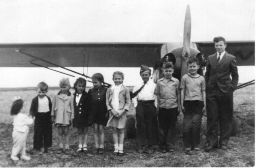 My father's Airplane - That's me on the far left.
