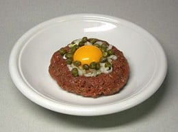 Beef Tartare: raw marinated meat with a raw egg on top