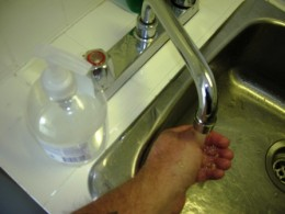 washing hands at kitchen sink