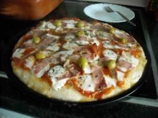 A picture of a scrumptious pizza by darioalvarez at flickr
