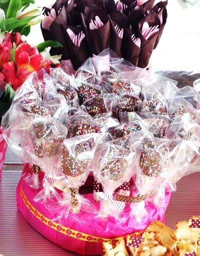 Chocolate covered marshmallow pops on a display