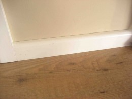 Skirting Board installed over the Edge of Hardwood Laminate Flooring