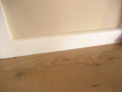 Skirting Board installed over the Edge of Hardwood Laminate Flooring