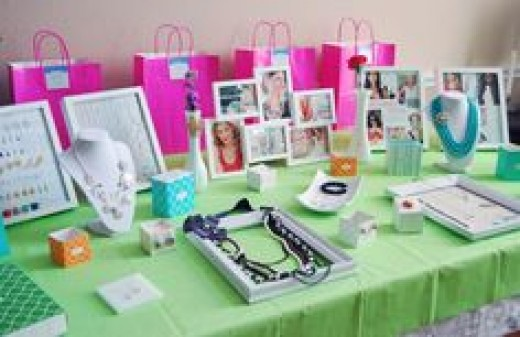 A cheery table display with colorful tablecloths and white picture frames