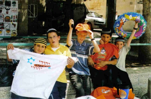 Othodox Jewish boys protesting the withdrawal of Gaza.  The color orange was the symbol of those in opposition.  The color blue was for the supporters of the withdrawal.