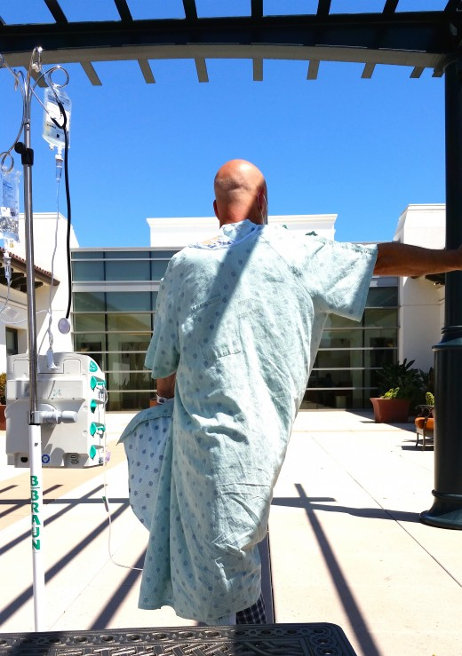 Standing side twist in the courtyard. I had to wear two hospital gowns, One to cover my back.