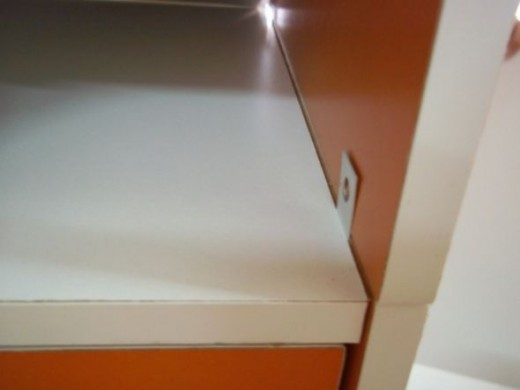 The 2 hole flat connector is now ready to connect the upper storage shelf.