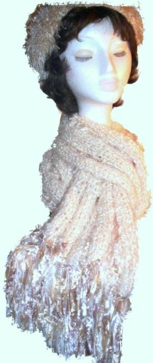 This scarf was created using Cream soft knobbly yarn with slim lengthwise stripes of Cream/Fawn 'Feathers' woven in.  It is 30cm wide x 205cm long, including 20cm Cream/Fawn 'Feathers' fringing, and also has a matching hat in Cream/Fawn 'Feathers' ya