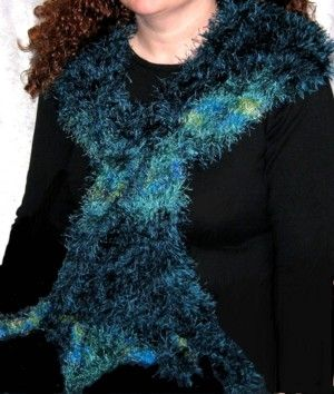 This scarf is several shades of  'Ostrich' yarn in a  glorious 'Peacock-like' combination of Aqua, Turquoise, Purple and Lime/Lemon, including 15cm twist knitted fringes each end.  It is over 2m long and can be pulled in to a neck scarf width, or sha