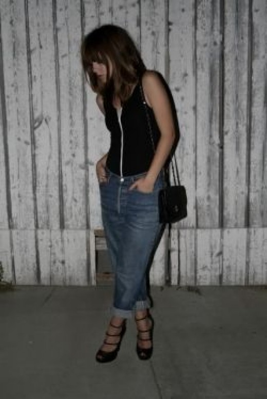 Leotard with boyfriend jeans, a small crossbody bag, and strappy heels is definitely on point.