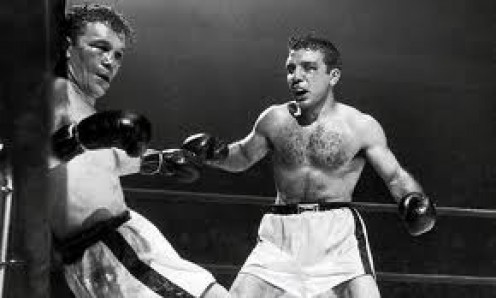 Jake LaMotta defended his world title with a come from behind 15th round knockout of Laurent Dauthielle.