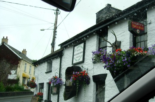 Cenarth pub with a coracle on display