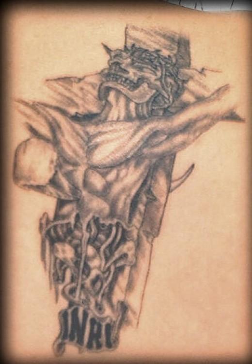 bizarre tattoo. Bizarre Cross Tattoo