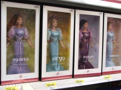 Zodiac collector dolls by Mattel include a Barbie featuring each of the zodiac signs.