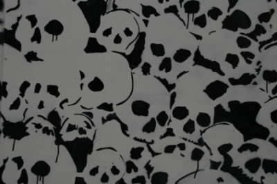 Create a spooky haunted house for Halloween by decorating with skulls and skeletons.