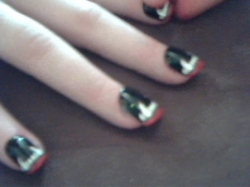 A closeup image of her Halloween nail art. She really enjoyed wearing them during the holiday festivities. However, you can paint your own if you like.