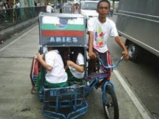 pedicab loaded with school children