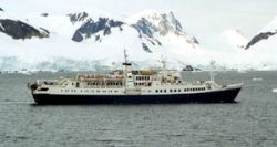 The Caledonian Star passing through Antarctica's Paradise Bay, February 2001, just days before being hit by a rogue wave. She was renamed the MS National Geographic Endeavour in June 2001. (Credit: Stan Shebs)