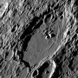 Image taken by MESSENGER on July 3, 2012, shows the crater Eitoku, including its central peaks that appear especially prominent due to the high solar incidence angle and the fact that this image has not been map projected. Central peaks are common in