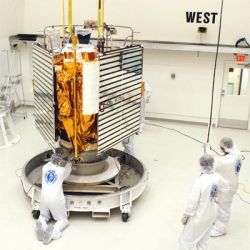 At Astrotech in Titusville, Fla., technicians with The Johns Hopkins University Applied Physics Laboratory (APL) prepare the MESSESNGER spacecraft for a move to a hazardous processing facility in preparation for loading the spacecraft's complement of