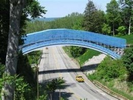 The Ravine Flyer II has 6 tunnels and this 165 foot arched bridge that spans the 4 lane Pennisnula Drive.