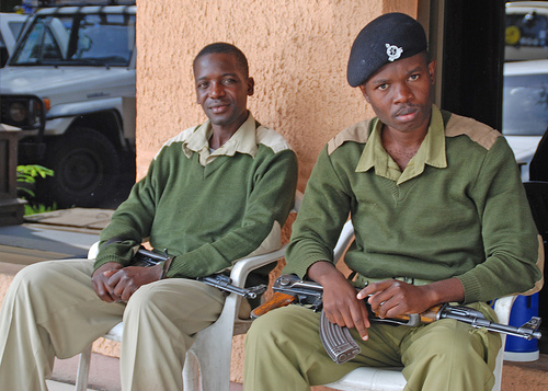 Two security men guarding a 5-star hotel in Arusha carrying loaded AK-47s