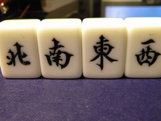 Winds: These honors can only be used to make sets. Four tiles of each Wind.Left to Right: North, South, East, West.