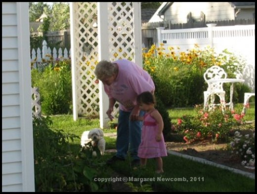 My momma (we call her granny) teaching her great-grand-daughter about veggies.