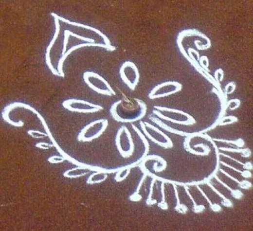 small rangoli with lamp