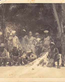 My father, on an island in the Pacific, before I was a twinkle in his eye. (the buff sailor in the middle)