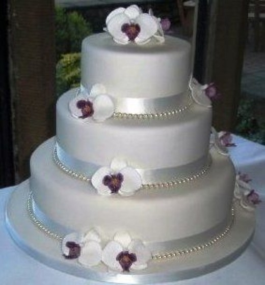 Orchid Wedding Cake - orchids made from sugar paste moulds, pearls are cheap costume jewelery strands
