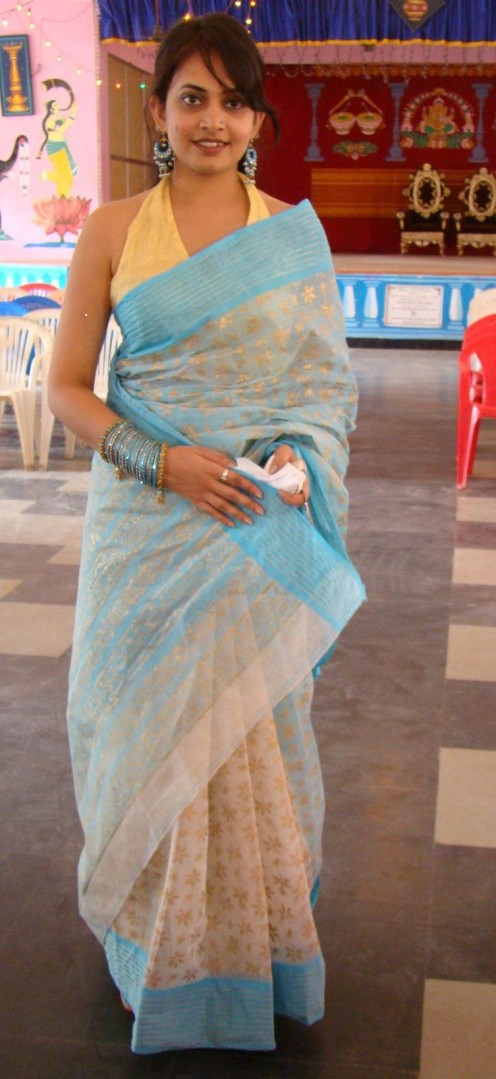 a beautiful housewive saree clad