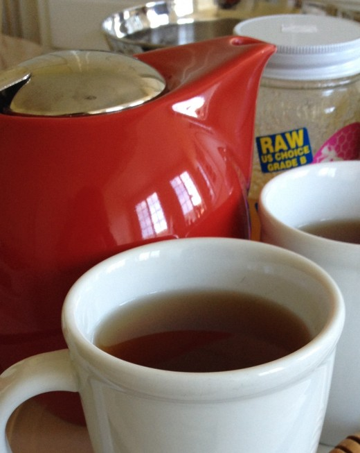 Hot tea with honey keeps us warm inside and out on cold days