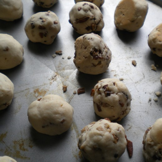 This picture shows the bottom lightly browned and they have puffed just a bit after baking.