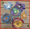 http://craftsbyamanda.com/2010/05/denim-fabric-flowers-denim-fabric.html
