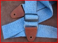 http://www.etsy.com/listing/69001857/recycled-blue-jeans-guitar-strap