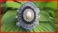 http://www.etsy.com/listing/76290901/bracelet-cuff-pearl-statement-piece-ooak