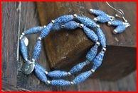 http://www.etsy.com/listing/88523812/blue-jean-paper-bead-set-2-stretch